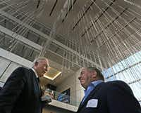 Dallas Cowboys owner Jerry Jones talks with Bruce Russo of Bruce Russo Designs as the Jones family hosts a news conference and reception to announce new tenants for The Star in Frisco on Thursday.((Louis DeLuca/The Dallas Morning News))