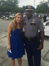 Reporter Naomi Martin and longtime Baton Rouge police spokesman Cpl. L'Jean McKneely outside the funeral for a slain officer in July in Baton Rouge. (Provided by Naomi Martin)