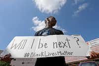 Niamke Ledbetter, of Oak Cliff, holds a sign at a Black Lives Matter protest on Park Lane in Dallas, Sunday, July 10, 2016. (Jae S. Lee/The Dallas Morning News) (Staff Photographer)