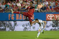 FC Dallas forward Atiba Harris (14) attempted a shot on goal while defended by Los Angeles Galaxy forward Raul Mendiola during a match at Toyota Stadium in Frisco in October. (File Photo/Ting Shen)
