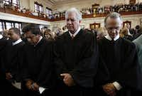 From left: Texas Supreme Court justices Dale Wainwright, David Medina, Paul Green and Phil Johnson took part during a moment of prayer on the opening day of a legislative session in Austin. (2011 File Photo/Vernon Bryant)