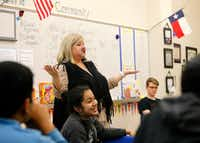 Sunnyvale High School teacher Becky Fisher plays a communication game with her video technology class.((Tom Fox/The Dallas Morning News))