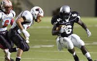 <p>Deandre Wilson (6) is shown during his high school playing days in 2008. </p>((Gary Payne/Denton Record-Chronicle) )