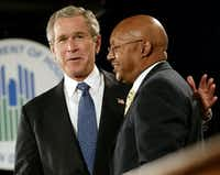 President George W. Bush embraced Alphonso Jackson before signing the American Dream Downpayment Act at the Department  of Housing and Urban Development on Dec. 16, 2003. Jackson was acting HUD secretary at the time and served as secretary in Bush's second term. (Stephen Jaffe/Agence France-Presse)