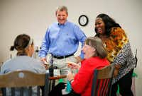 Incoming Allen ISD Superintendent Scott Niven (standing, left) laughs with teachers and principal Shondra Jones (standing, right) at Shields Elementary in Red Oak, , where he is the outgoing superintendent. (Tom Fox/The Dallas Morning News)(Staff Photographer)