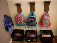 "<p></p><p></p><p>Backpacks and school work are highly organized at Mineral Wells foster parent Angela Cook's house. (<a name=""firsthit"" id=""firsthit""></a>Nathan Hunsinger/Staff photographer)</p><br><p></p><p></p>"