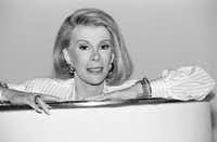 """<p></p><p>Joan Rivers announces that she is starting a new syndicated talk show, &nbsp;<i>The Joan Rivers Show</i>, &nbsp;in 1989.</p>(<p><span style=""""font-size: 1em; background-color: transparent;"""">DMN file/AP Photo/Nick Ut</span><br></p><p></p>)"""
