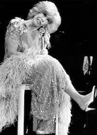 Joan Rivers performs before a packed house at the Loews Anatole's Mistral club in Dallas on July 16. 1984. ((DMN file))