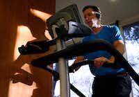 AFTER: Paul Thomas works out on the stair climber at Cooper Aerobics Center in Dallas.  Thomas lost weight after adjusting his diet to eat more protein. (Nathan Hunsinger/Staff Photographer)