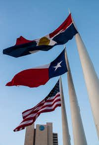 Dallas' official flag flies in front of Dallas City Hall. Because it has no choice.((Ashley Landis/Staff Photographer))