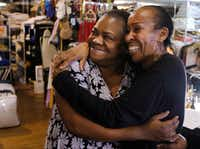 <p>Angela Jessie (left) visited a nonprofit thrift store where Cleo Sims helped her pick out clothes after she was released from jail. Jessie spent two months in the Dallas County Jail because she couldn't make bail on a shoplifting charge. (David Woo/Staff Photographer)</p>