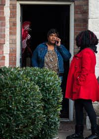 Jacqueline Craig talks on the phone as she leaves her house with attorney Jasmine Crockett on Thursday in Fort Worth. Police were investigating the arrest of Craig and her two daughters on Wednesday by a Fort Worth officer who was caught on video wrestling Craig to the ground and pointing a stun gun at her daughter(<p>(Smiley N. Pool/The Dallas Morning News)</p>)