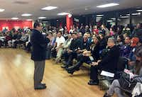 Mexican Consul General Francisco de la Torre addresses a large crowd at a recent community meeting in which fears were discussed about deportations of unauthorized immigrants. (Dianne Solis/Staff)