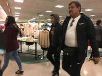 Salvador Quiroz and his son and daughter shop for gifts. The Quiroz family drove 289 miles from Delicias, Chihuahua, to El Paso to spend their holiday cash.((Angela Kocherga/Staff))
