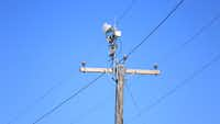 Instead of laying fiber, AT&T could use plastic antennas placed along power lines to deliver ultra high-speed internet to homes and smartphones.(Courtesy of AT&T)