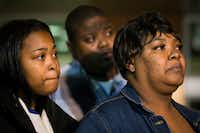 Jacqueline Craig (right) attends a press conference with her 15-year old daughter (left) and cousin Rod Smith outside the Fort Worth Police Department Bob Bolen Public Safety Complex on Dec. 22 in Fort Worth. Fort Worth police said Thursday they are investigating how an officer treated Craig and her two daughters after a viral video shows he forced the woman to the ground and pointed a stun gun at the teens.(Staff Photographer/Smiley N. Pool)