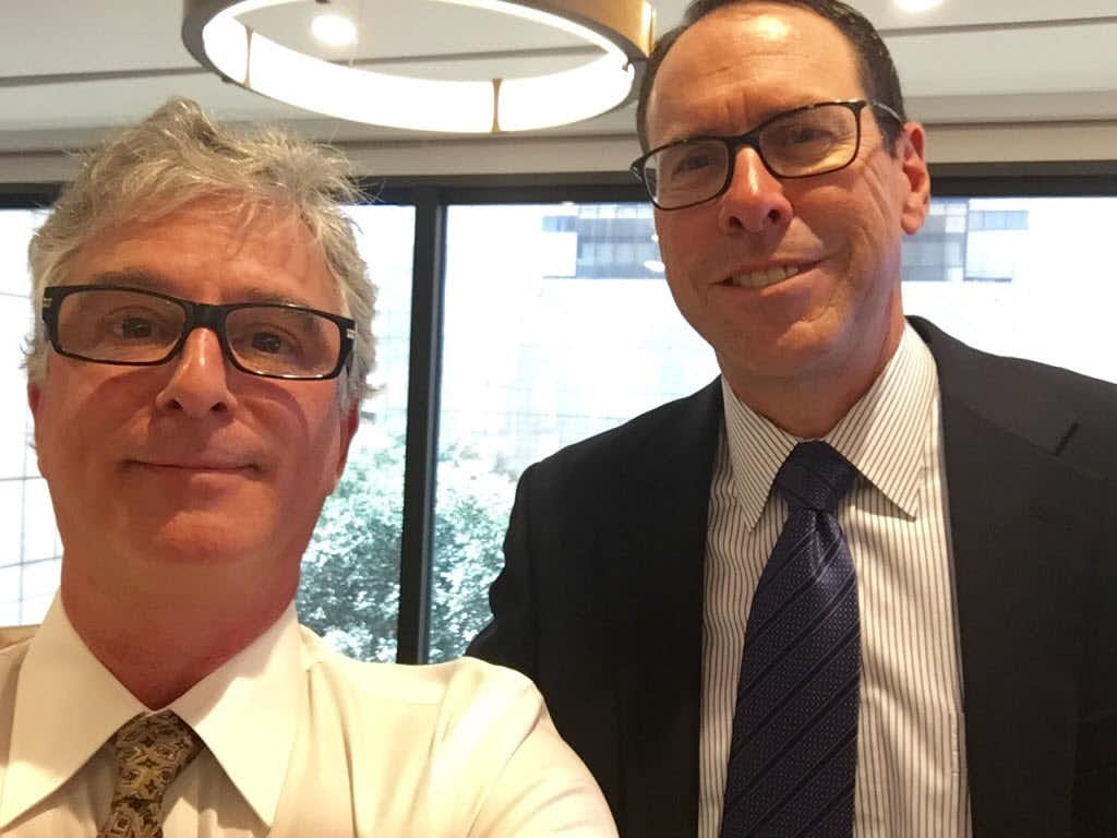 Watchdog Dave Lieber and AT&T president and CEO Randall Stephenson in Stephenson's office talking about AT&T's customer service. Stephenson is now trying to buy Time Warner.