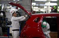 Employees at work in the multibillion-dollar Honda car plant in Celaya, in the central Mexican state of Guanajuato. The factory is part of a national manufacturing boom that has turned the auto industry into a bigger source of dollars than money sent home by migrants. ((Eduardo Verdugo/The Associated Press))