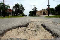 A pothole on Madison Avenue near Eighth Street in Oak Cliff on June 08, 2010 in Dallas. (Ben Torres/Special Contributor).