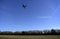 A plane takes off over the grass portion of the runway at Aero Country Airport in McKinney, Texas on Dec. 16, 2014. (Rose Baca/The Dallas Morning News)Staff photographer