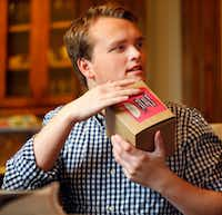 "<span style=""font-weight: normal;"">Jon Heighten has been packaging Smile Biscotti gift boxes at his parents University Park home since November.  The gifts are part of Jon's daily skills enhancement as he struggles with autism. (Tom Fox/The Dallas Morning News)</span>(Staff Photographer)"