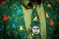 "A man in the audience wears a sticker showing Nelson Koscheski after a performance of Koscheski's poems set to music by Ryan Flanigan at The Canterbury House at SMU on Thursday, Dec. 1, 2016, in Dallas.(<p><span style=""font-size: 1em; background-color: transparent;"">(Smiley N. Pool/The Dallas Morning News)</span><br></p><p></p>)"