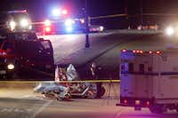 Three were confirmed dead after two airplanes collided in midair near Custer Road and Virginia Parkway in McKinney on Saturday. (Vernon Bryant/Staff Photographer)