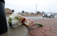White roses were left on Custer Road in McKinney near the scene of Saturday evening's plane crash. (Vernon Bryant/Staff Photographer)