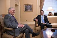 Senate Majority Leader Mitch McConnell, R-Ky., met with the Energy Secretary-designate, former Texas Gov. Rick Perry, on Wednesday. (J. Scott Applewhite/The Associated Press)