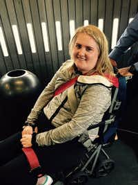 Sarah Milburn, 24, of University Park, was paralyzed after a crash in a van involving an Uber driver. She is paralyzed from the mid-chest down but has regained some use of her hands.