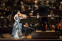 Guest conductor Matthias Pintscher points to violin soloist Karen Gomyo as she performs with the Dallas Symphony Orchestra at the Morton H. Meyerson Symphony Center on Thursday, Jan. 5, 2017, in Dallas. (Smiley N. Pool/The Dallas Morning News)(Staff Photographer)