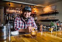 Mixologist Manny Casas of Rye in McKinney makes a cocktail called a Cherry Boom-Boom. (Ashley Landis/Staff Photographer)