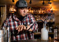 "<p><span style=""font-size: 1em; background-color: transparent;"">Mixologist Manny Casas at Rye in McKinney smokes cherry wood and cinnamon in a bottle while making a cocktail called a Cherry Boom-Boom.</span></p>((Ashley Landis/Staff Photographer))"