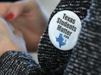 "North Texas superintendents and trustees wore ""Texas Students Matter"" buttons during a press conference on legislative priorities.Louis DeLuca/The Dallas Morning News"