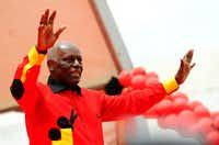 This file photo taken on August 29, 2012 shows Angolan President Jose Eduardo dos Santos Angolan greeting the crowd during the final election campaign rally in Kilamba Kaixi on the outskirts of Luanda. Angolans endured a bloody civil war and extreme poverty as for nearly 40 years power rested solely in the hands of autocratic President Jose Eduardo dos Santos. State radio's announcement on Friday that he will stand down next year appears to be the beginning of the end of one of Africa's longest reigns, and could open a new chapter for a country largely closed off to the outside world. SAKUTINSTEPHANE DE SAKUTIN/AFP/Getty Images(AFP/Getty Images)