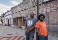 Jay Scroggins, left, and George Battle III plan to open the Fair Park District Entrepreneur Center in the building in the background at Martin Luther King Jr. Blvd. and Malcolm X Blvd.  The goal of the center is to provide tools to local residents who would like to start or grow their business.(Rex C. Curry/Special Contributor)