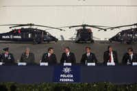 Mexico's Secretary of Public Safety Genaro Garcia Luna, center, speaks with U.S. Ambassador to Mexico Carlos Pascual, third right, during the delivery ceremony of three U.S. made helicopters to the Mexican government in Mexico City on Nov. 24, 2010. (Alxandre Meneghini/AP)