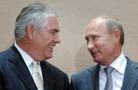 Tillerson meets on Aug. 30, 2011, with Russia's then-prime minister Vladimir Putin in Sochi, Russia. (Alexei Druzhinin/RIA Novosti via AP, Pool)