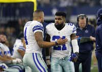 Dallas Cowboys' Dak Prescott (left) and Ezekiel Elliott (21) talk on the sideline during an NFL football game against the Detroit Lions on Dec. 26, 2016, in Arlington. ((Roger Steinman/The Associated Press))
