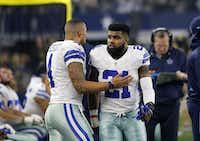 Dallas Cowboys' Dak Prescott (left) and Ezekiel Elliott (21) talk on the sideline during an NFL football game against the Detroit Lions on Dec. 26, 2016, in Arlington.((Roger Steinman/The Associated Press))