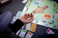<p>Hasbro Inc. began the Monopoly Token Madness Vote, a worldwide contest to let people choose the eight tokens to be included in the game's next generation.</p>((The New York Times))