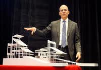 Brian Trubey, HKS executive vice president and director of sports and entertainment, displays models of what the new Texas Rangers ballpark seating area could look like. The model on the left represents seating in the new stadium, while the one on the right represents the existing seating structure.((Tom Fox/Staff Photographer) )