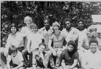 "On the rare nights when Tony Reed, now 61, can't sleep, he focuses on  what he calls ""the most peaceful time of my life."" He was 16 or 17, in training to be counselor at Camp Sherwood Forest in Missouri, and spent a week in the wilderness with friends. In this photo, he's third from the right on the back row.(Photo: Tony Reed)"