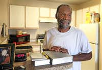 Harvey Pollard, with his Bibles, in his tidy Eban Village apartment((Louis DeLuca/Staff photographer))