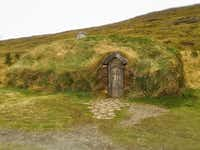 Adjacent to the actual archeological site is a replica of Erik the Red s house where Leif Erikson was born, Eiriksstadir. (Paul Ross)