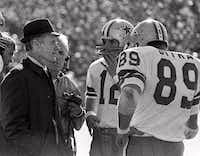 Dallas Cowboys coach Tom Landry talks with quarterback Roger Staubach (12) and tight end Mike Ditka (89) during the 1972 Super Bowl game against Miami on Jan. 16, 1972. That was the year David Weigand was born.The Associated Prss
