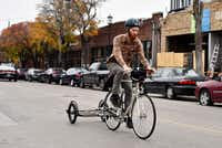 Mark Draz, 29, a library associate at the downtown Dallas branch, rides a prototype model of the book bike attached with a trailer in Deep Ellum. The Dallas Public Library and Local Hub Bicycle Co. are partnering to create a bookbike, a bike that transports a small mobile library to the community.&nbsp;<div><br></div>((Ben Torres/Special Contributor))