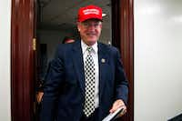 "Rep. Mike Conaway, R-Texas, wearing a ""Make America Great Again"" hat, leaves a House Republican leadership meeting on Capitol Hill in Washington last year. <div><br></div>((File Photo/The Associated Press))"