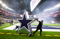 Dallas Cowboys workers rush one of the pregame pyrotechnics off the field before the opening kickoff of an NFL football game against the Detroit Lions at AT&T Stadium on Monday, Dec. 26, 2016, in Arlington, Texas.Smiley N. Pool/Staff photographer