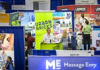 Sammy Aldeeb, founder & CEO of Urban Bricks Pizza Co., gestures at talks to a visitor to the company's booth the at Franchise Expo South Kay Bailey Hutchison Convention Center in Dallas. (Smiley N. Pool/The Dallas Morning News)Staff Photographer